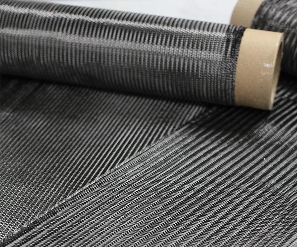 "Quantum复合材料有限公司推出了""Forged Preg"",它能够像传统SMC材料一样模压成型。该品牌的3种新的连续碳纤维增强SMC都采用了专有的乙烯基酯混合物,此图仅显示的是编织织物"