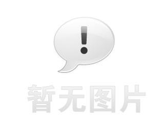 图6 这张图展示了两种自动化形式。L形臂将非接触式传感器放在主轴面附近,实时补偿主轴的膨胀或收缩。左上方的冷却剂喷嘴自动调整,根据已知的刀具长度将冷却剂喷嘴朝向刀具尖端
