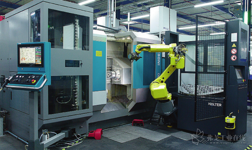 图 1 这一自动化系统的特点是镜像配置,与标准型版本不同,机器人位于左侧,否则会因可编程序 控制器而影响加工机床的敞开性